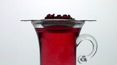 Fruit tea in a tea glass Stock Footage