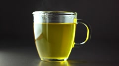 A cup of chamomile tea Stock Footage
