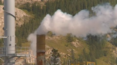 Industrial plant steam exhaust long shot Stock Footage