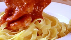 Serving ribbon pasta with tomato sauce and prawns - stock footage