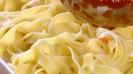Serving ribbon pasta with tomato sauce Stock Footage