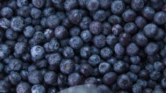 Blueberries with spoon (full-frame) Stock Footage