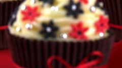 Three cupcakes decorated with sugar flowers and silver dragees Stock Footage