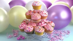 Decorated cupcakes and balloons Stock Footage