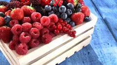Assorted berries in a crate - stock footage