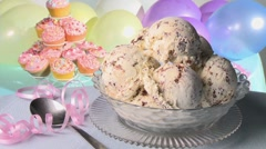 Ice cream sundae, cupcakes and balloons in background Stock Footage