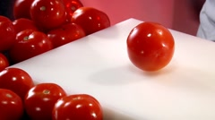 Slicing a tomato Stock Footage