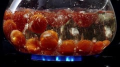 Tomatoes in boiling water Stock Footage