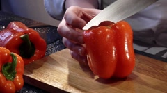 Halving and coring a red pepper Stock Footage