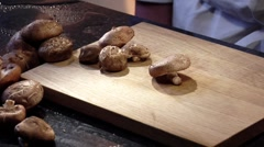 Slicing shiitake mushrooms - stock footage