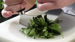 Chopping flat-leaf parsley Stock Footage