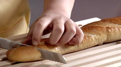 Slicing a baguette Stock Footage
