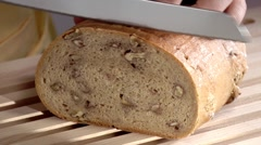 Slicing walnut bread Stock Footage