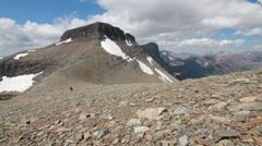 Mountain climbing towards summit peak female Stock Footage