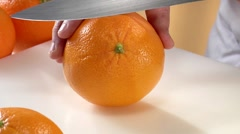 Peeling an orange with a knife Stock Footage