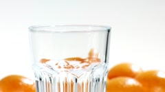 Pouring orange juice into a glass (close-up) - stock footage