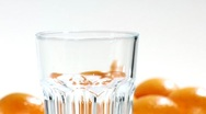 Stock Video Footage of Pouring orange juice into a glass (close-up)