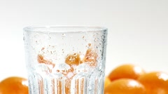 Pouring orange juice into a chilled glass (close-up) Stock Footage