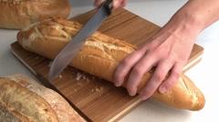 Slicing baguette Stock Footage