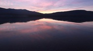 Stock Video Footage of Reflection of mountains at sunset on a lake