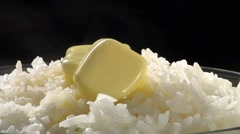 Rice with knobs of butter Stock Footage