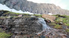 Waterfall with rocky mountains Stock Footage