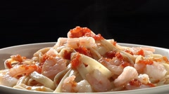 Ribbon pasta with prawns, tomato sauce and parsley - stock footage