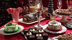Biscuits, cakes and gingerbread house on Christmas cake buffet Stock Footage