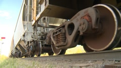 Railroad, ore train low angle slows down Stock Footage