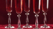 Stock Video Footage of Pouring sparkling rosÈ wine into glasses
