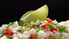 Rice with chilli sauce and lime wedges Stock Footage