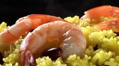 Yellow rice with prawns and red kidney beans Stock Footage