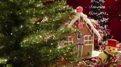 Gingerbread house behind Christmas tree Stock Footage