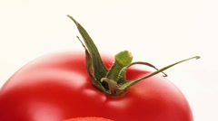 Half a tomato in front of whole tomatoes Stock Footage