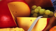 Various cheeses with grapes - stock footage