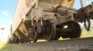 Stock Video Footage of railroad, ore train low angle slows down with diesel locomotives,