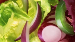 Salad leaves with onion, radishes and green and red pepper Stock Footage