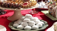 Gingerbread house and sweet baking on Christmas cake buffet Stock Footage