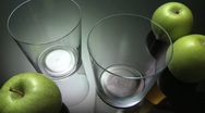 Stock Video Footage of Pouring apple juice into glasses