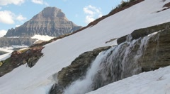 Watefall with rocky mountain peak in the background Stock Footage