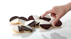 A pile of black-and-white cookies and a hand taking one Stock Footage