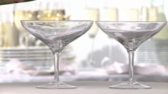 Champagne being poured into two glasses Stock Footage