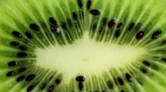 Stock Video Footage of A slice of kiwi (close up)