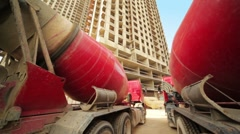 Between two concrete mixer near unfinished house Stock Footage