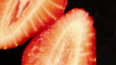 A strawberry cut in half Stock Footage