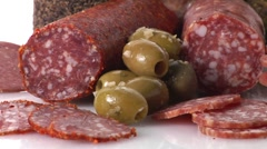 Various types of salami and green olives Stock Footage