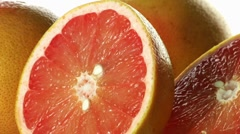 Grapefruits, whole and halved Stock Footage