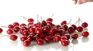 Stock Video Footage of A pile of cherries and a hand taking one