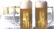 Stock Video Footage of Hands clinking beer glasses
