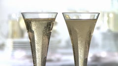 Toasting with champagne flutes - stock footage
